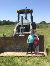 siblings on the tractor