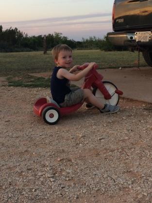 boy playing on big wheel