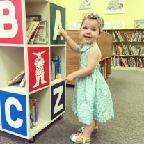toddler girl in the library